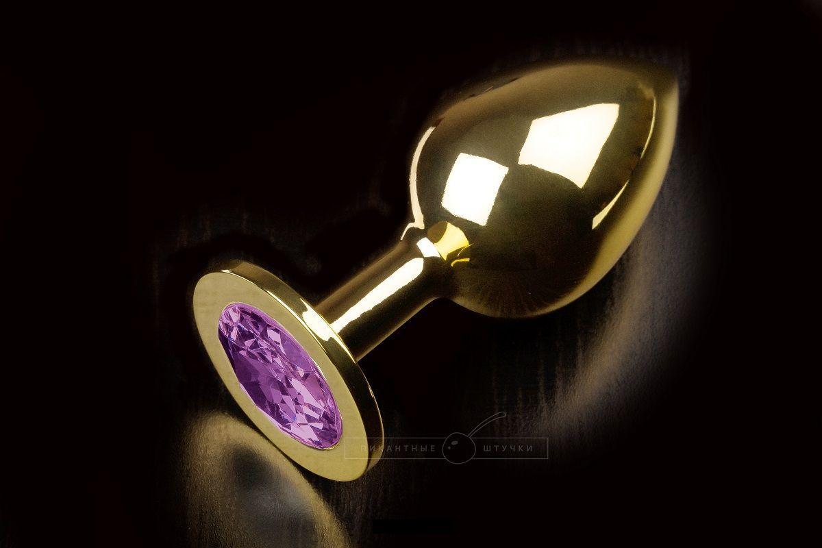 Большая золотая анальная пробка с закругленным кончиком и фиолетовым кристаллом - 9 см.-5700