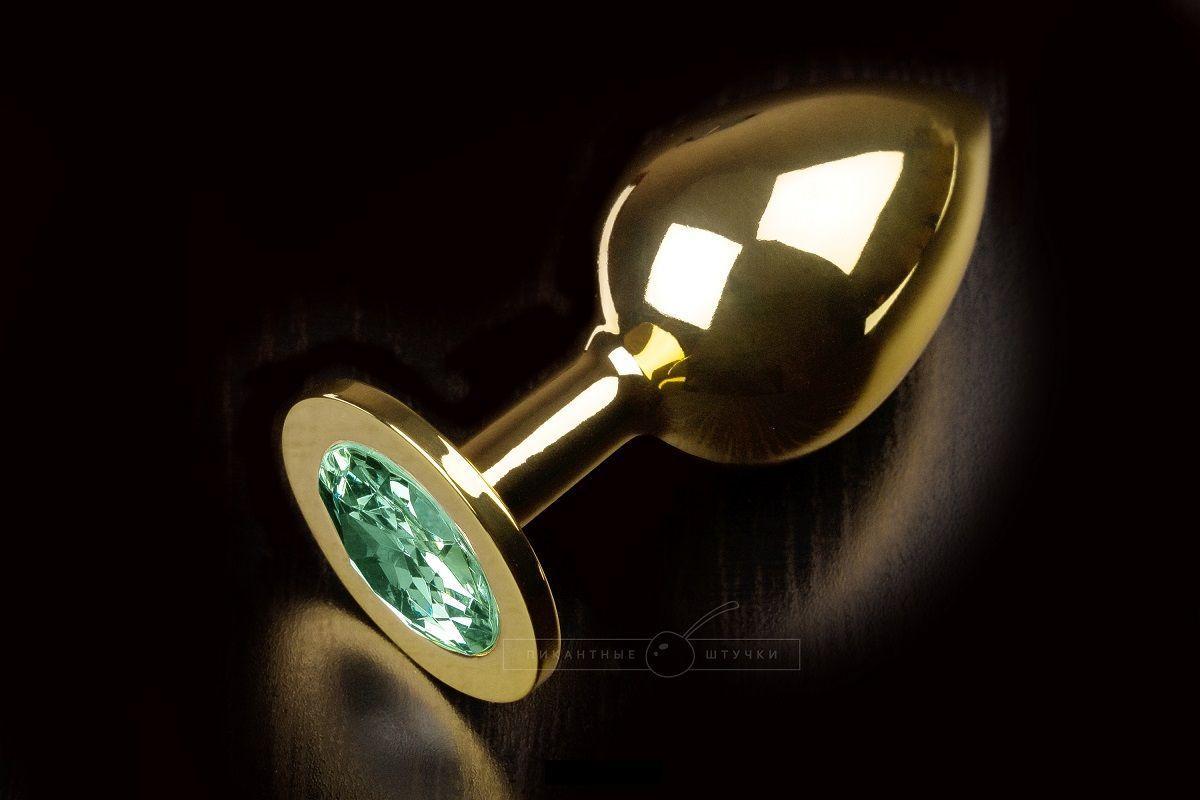 Большая золотая анальная пробка с закругленным кончиком и изумрудным кристаллом - 9 см.-5687